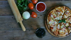 4K footage of hand keeping slice of pizza,melted cheese dripping. View top Stock Footage