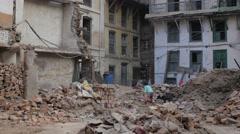 Girl playing between ruined house,Kathmandu,Nepal Stock Footage