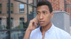 Close up, Phone Talk by Young Black Man , Side View Outdoor Stock Footage