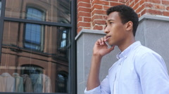 Phone Talk by Young Black Man , Side View Outdoor Stock Footage