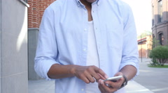 Close Up of Man Walking and Using on Phone, Outdoor Front View Stock Footage