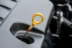 The oil dipstick of a car engine Stock Photos