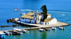 Vlacherna Monastery Kanoni, dock boat station pier. Greece Corfu marina 4k video Stock Footage