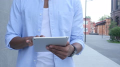 Close Up of Walking Man and Using Tablet for Browsing, Outdoor Stock Footage