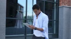 Walking Black Man Using Tablet for Browsing, Slow Motion Stock Footage