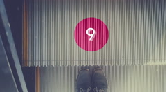 Countdown from 10 to 0 on escalator with halt feet, Stock Footage