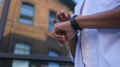 Browsing Online on Smartwatch, Standing Young Black Male Designer Stock Footage