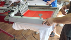 Screen printing manufacturing on t-shirts Stock Footage