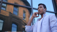 Talking on Smartphone, Standing Young Black Male Designer Stock Footage