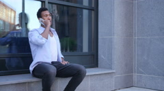 Attending Phone Call, Talking while Sitting Outdoor Stock Footage