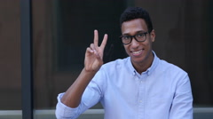 Gesture of Success, Victory Sign by Young Black Handsome Man Stock Footage