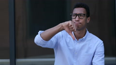Gesture of Unsatisfaction, Thumbs Down by Young Black Handsome Man Stock Footage
