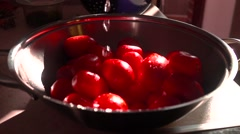 Pouring water over red tomatoes in a pan. Super slow motion video Stock Footage