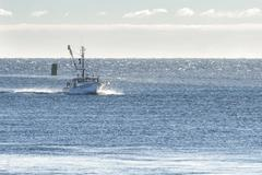 Fishing boat approaching Cape Cod Canal Stock Photos