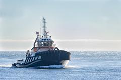 Tugboat on windy Cape Cod Bay Kuvituskuvat