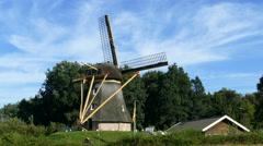 Dutch Windmill on small hill at bleu sky Stock Footage