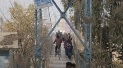 School kids and people crossing suspension bridge,Kathmandu,Nepal Stock Footage