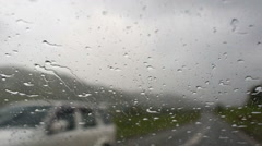 Drops on the windshield of the car. The car rides in the mountains. Stock Footage