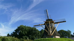 Dutch Windmill on small hill at bleu sky, time lapse Stock Footage