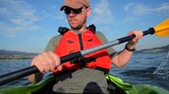 Caucasian Sportsman Kayak Tour on the Lake. Kayaking Theme. Stock Footage