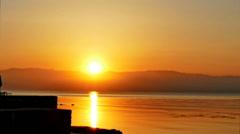 Sunrise water sea ocean nature twilight HD time-lapse video. Red sun rise sky Stock Footage