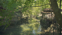 Wooden summer hut on a tropical river Dymchay, Turkey Stock Footage