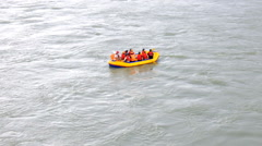 Small raft in middle of a huge tumultuous a great mountain river Stock Footage