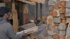 Man cutting wood in sawmill,Kathmandu,Nepal Stock Footage