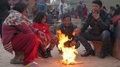 Family sitting around  bonfire,Kathmandu,Nepal Stock Footage