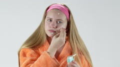 Teenage girl with a problem face skin applying cleansing skincare lotion Stock Footage