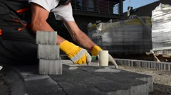 Caucasian Worker Paving Garden Path. Cobble Paving Stock Footage