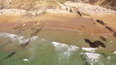 People having fun on a beautiful sandy beach aerial view Stock Footage