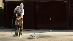 High Water Pressure Brick Washing. Caucasian Worker Cleaning Driveway. Stock Footage