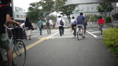 Bicycle lane sharing on street in Japan, slow motion Stock Footage