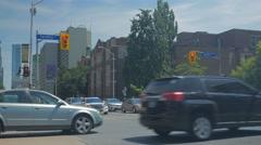Bloor Spadina Street Signs Stop Lights Intersection Pedestrians Crosswalk Stock Footage
