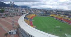 Sailing over the seats and stands of Estadio Campin stadium in Bogota Stock Footage