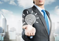 Businessman holding creativity icon Stock Photos