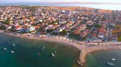 Flying over Croatia Vir island apartments at summer sunrise 4K Stock Footage