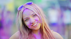 Excited face of happy young lady smiling to camera, having fun at Holi festival Stock Footage