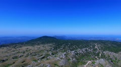Corfu Greece mountain summit terrain aerial 4k video. Hills peak, blue sky Stock Footage