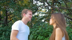 Young couple quarrel. The girl and the guy swear. Stock Footage