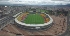 Sailing over Estadio Campin stadium to the old sports arena in Bogota Stock Footage