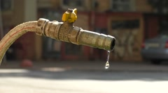 Time lapse of leaky water spigot in urban.  Stock Footage