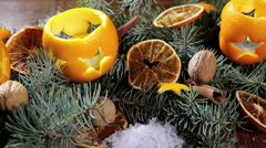 Dried orange slices and oranges with cloves. Christmas decorations Stock Footage