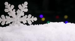 Brilliant white snowflake on a snow Stock Footage
