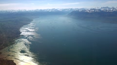 Flying over the Geneva (Leman) lake with the Alps Stock Footage