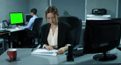 4K: A young controller is analyzing some financial reports in an office Stock Footage