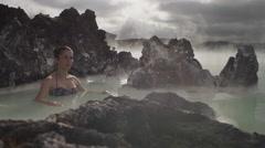 Beautiful woman walking in hot spring pool Stock Footage
