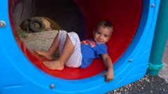 Adorable child rests and slides down Stock Footage