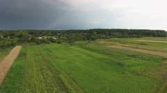 View from drone of village near forest before storm Stock Footage